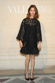 Sofia Coppola looked ultra chic in a black lace dress with a feather hem at the Valentino Couture Spring 2019 show.