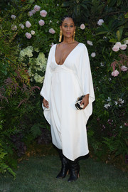 Tracee Ellis Ross punctuated her look with a black-and-white printed clutch.