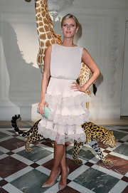 Nicky Hilton chose this lovely and romantic blush-colored tiered lace dress for the Valentino runway show.