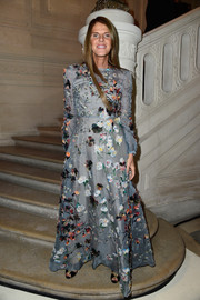 Anna dello Russo looked enchanting in a floral-appliqued slate-blue gown by Valentino at the label's Couture fashion show.