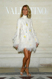 Celine Dion polished off her look with silver ankle-strap sandals.