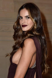 Izabel Goulart swiped on some dark red lipstick to match her dress.