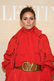 Olivia Palermo punctuated her red outfit with a tan Valentino logo leather belt.