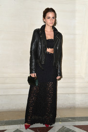 Emma Watson polished off her edgy-glam ensemble with a Valentino crocodile purse.