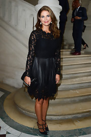 Princess Madeleine looked simply lovely in lace when she wore this long-sleeve frock that featured a knee-length lace-trimmed skirt.