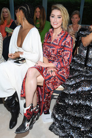 Amber Heard toughened up her cute dress with a pair of cowboy boots for the Valentino Couture Fall 2018 show.