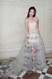 Lulu Tan was angelic with a fun twist in this white Valentino Couture musical note-print gown during the label's fashion show.