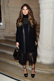 Miroslava Duma was hippie-glam in a fringed and studded suede vest by Valentino during the label's Couture fashion show.