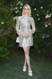 Lucy Boynton looked party-ready in a sequin-striped mini dress by Valentino during the label's Couture Fall 2018 show.