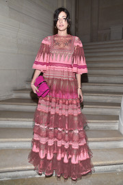 Eleonora Carisi couldn't be missed in this tiered, embroidered Valentino confection when she attended the label's Haute Couture show.