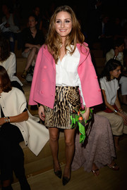 Olivia Palermo matched an animal-print mini skirt with a pink swing jacket for the Valentino fashion show.