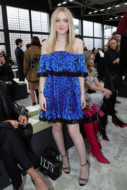 Dakota Fanning was breezy in a metallic blue off-the-shoulder print dress at the Valentino Fall 2018 show.