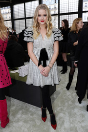 Ava Phillippe's red footwear stood out so elegantly thanks to those inky tights!
