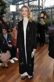 Natalia Vodianova arrived for the Valentino fashion show wearing an embroidered wool coat from the brand.