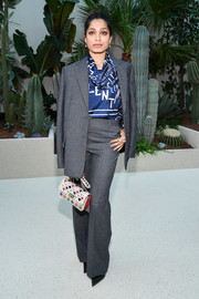 Freida Pinto teamed a gray suit with a printed silk blouse, all by Valentino, for the brand's Spring 2019 show.