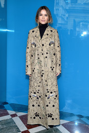 Miroslava Duma donned a floor-length beaded coat by Valentino for the label's fashion show.