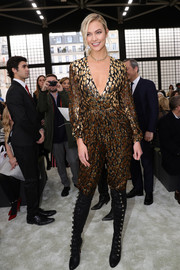 Karlie Kloss punched up her look with a pair of military-inspired knee-high boots by Christian Louboutin.