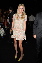 Nicky Hilton teamed her cute dress with a pair of Valentino Rockstud pumps in neon yellow.