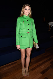 Olivia Palermo wore a stylish Valentino short suit in a popping green hue during the label's fashion show.