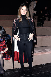 Miroslava Duma kept cozy in a black turtleneck for the Valentino fashion show.