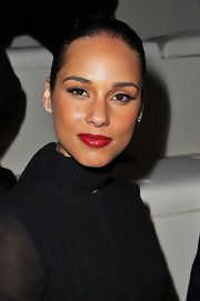 Alicia Keys attended the Valentino fall 2012 ready-to-wear runway show in Paris wearing a glossy red lipstick.