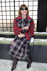 Anna Wintour bundled up in a mixed-plaid coat for the Valentino Fall 2018 show.