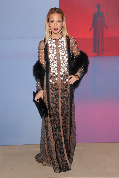 Stylist Rachel Zoe turned heads in a gorgeous embroidered gown, which she accessorized with a fur stole and oversize black leather clutch.