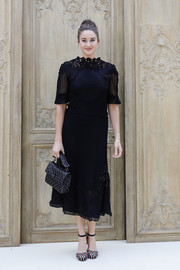 Shailene Woodley finished off her ensemble with a studded, quilted purse by Valentino.