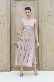 Olga Kurylenko looked ethereal in a pleated dusty-pink cocktail dress while attending the Valentino fashion show.