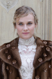 Diane Kruger styled her hair into a messy ponytail for the Valentino fashion show.