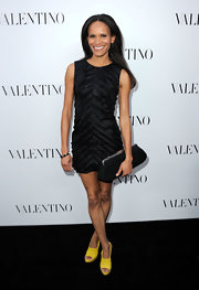 Amanda Garrigus carried this oversize black frame clutch to the Valentino store opening on Rodeo Drive.