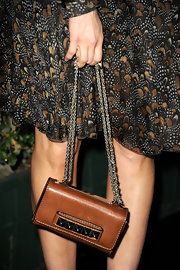 Abigail Spencer carried this tiny chain shoulder bag to the Valentino store launch.