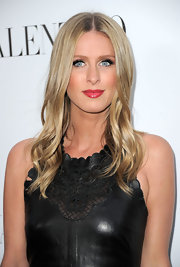 Nicky Hilton applied a glossy rosy raspberry lipstick for the Valentino store opening in Beverly Hills.