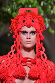 Kaia Gerber walked the Valentino Couture Fall 2019 show wearing an elaborate red hat.