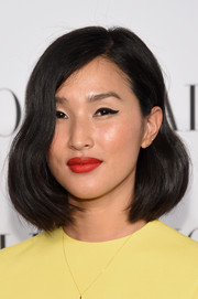 Nicole Warne's red, red lips contrasted nicely with her yellow dress.