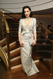 Dita Von Teese was a vision in a white brocade gown by Carolina Herrera at the Van Cleef & Arpels cocktail party.