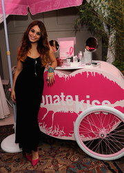 Vanessa Hudgens complemented her dark dress with a pair of pink Dina pumps by Alice + Olivia when she attended the Donate with a Kiss event.