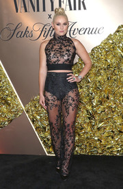Lindsey Vonn flashed plenty of skin in a sheer, star-emboidered crop-top and matching pants at the Vanity Fair 2019 Best Dressed List event.