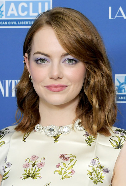 Emma Stone played up her eyes with a swipe of lilac eyeshadow.