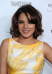 Udita Goswami rocked soft ringlet curls and side swept bangs at the Vanity Fair benefit party.