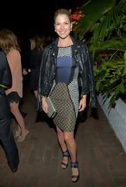 Ali Larter draped a leather jacket over her shoulders for a cool and tough vibe at the 2013 Vanities Calendar event.