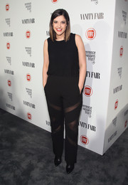 Catherine Valdes attended the Fiat Young Hollywood celebration wearing a black jumpsuit with sheer panels on the pants.
