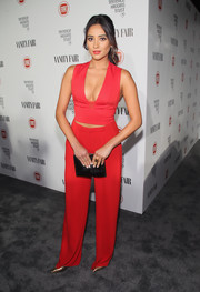 Shay Mitchell showcased cleavage and abs in a tight-fitting red crop-top during the Fiat Young Hollywood celebration.