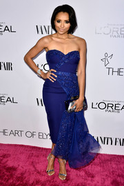 Kat Graham looked dreamy at the Vanity Fair Campaign Hollywood kickoff in a royal-blue Mikael D strapless dress with draped and beaded detailing.