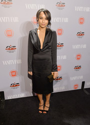 Zoe Kravitz completed her look with a simple yet elegant gold box clutch.