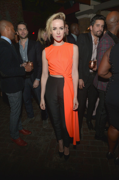 Jena Malone was ultra chic at the Young Hollywood celebration in a midriff-baring orange and black Roksanda Ilincic jumpsuit with draped detailing.