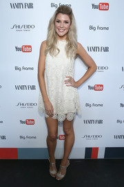 Grace Helbig teamed her dress with vintage-chic T-strap heels.