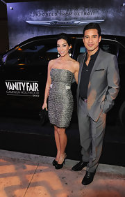Courtney Mazza wore this strapless silver textured dress to the Eva Longoria Foundation celebration.