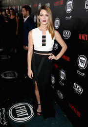 Ashley Greene flashed a hint of cleavage and abs in a monochrome cutout crop-top by SAFiYAA during the Vanity Fair and Fiat Young Hollywood celebration.