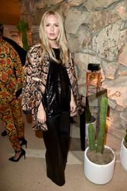 Rachel Zoe arrived for the launch of Proenza Schouler's Arizona fragrance wearing a leopard-print fur coat.